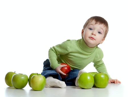 child with healthy food red and green apples photo