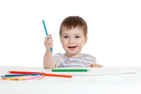 funny baby boy drawing with color pencils photo