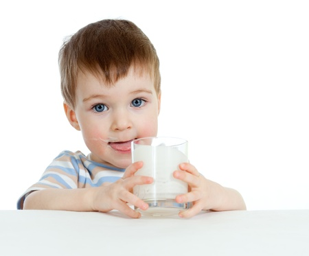 milk products: baby drinking yogurt or kefir over white Stock Photo