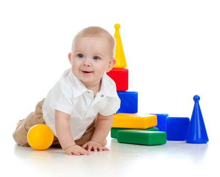 happy baby: little boy playing with building blocks
