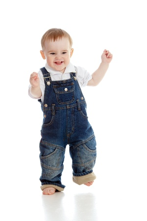 Funny baby boy is running  Studio shot  photo