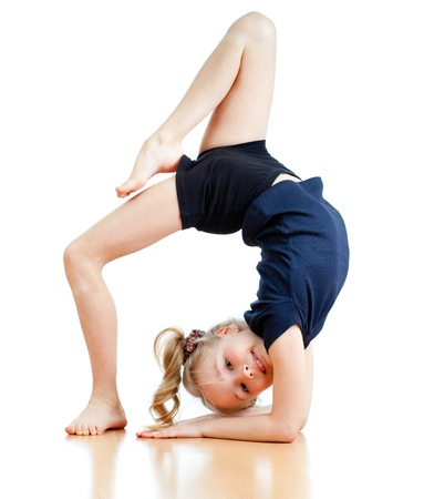 gymnastics sports: young girl doing gymnastics over white background