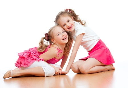Two girls are playing together  Isolated over  white background photo