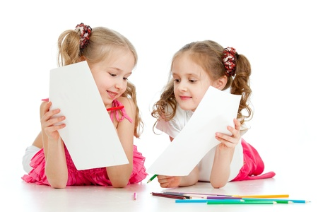 two girls drawing with color pencils together over white Stock Photo - 12584079