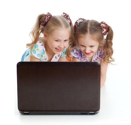 cute girlfriends smiling and looking at the laptop Stock Photo - 12584080