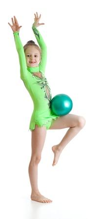 acrobat gymnast: young girl gymnast over white background