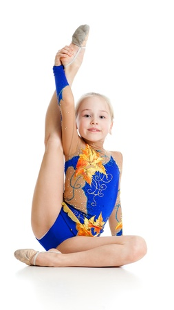 pretty girl gymnast over white background photo