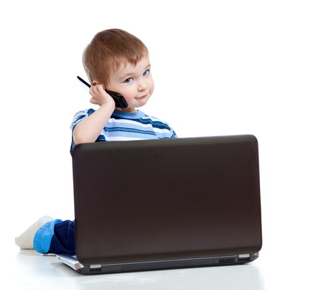 Child with laptop and mobile phone photo