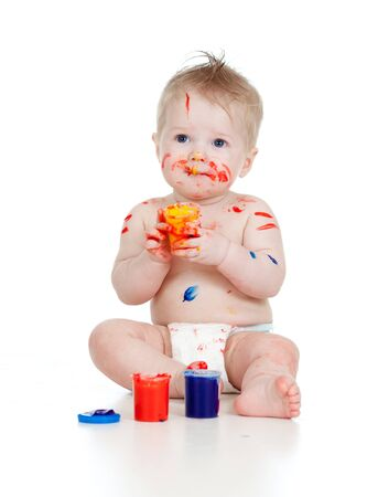 Happy dirty child with paints  Isolated on white background photo