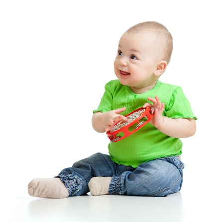 Child playing with musical toy  Isolated on white background photo