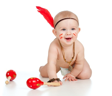 indian warrior: smiling indian  boy baby with maracas and feather