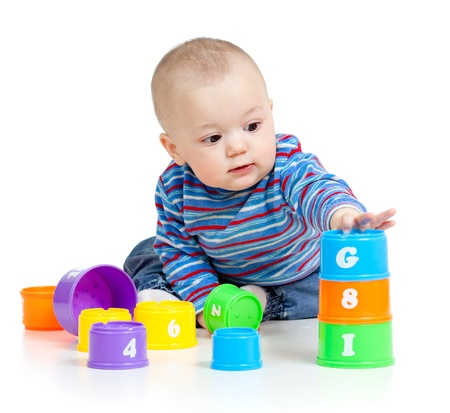 baby is playing with educational toys over white background photo