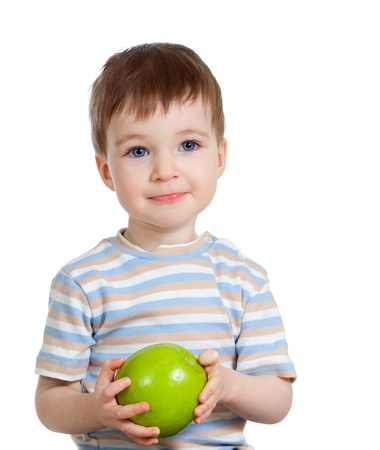 feed up: Baby boy holding and eating green apple, isolated on white