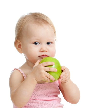 baby girl with green apple photo