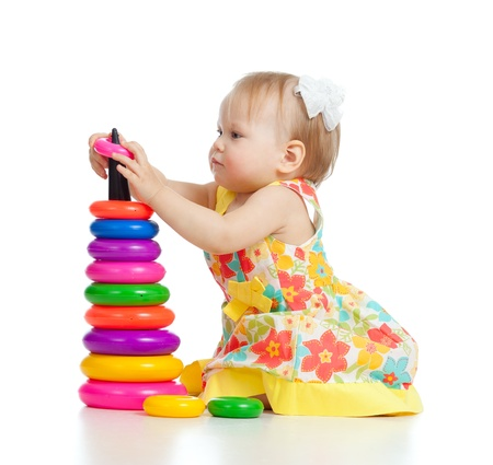 pretty little girl playing with color toy photo