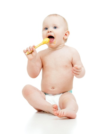 kasha: Little baby feeding with a spoon Stock Photo