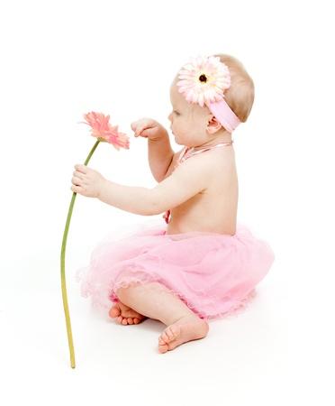 白で隔離され、花とかわいい女の子