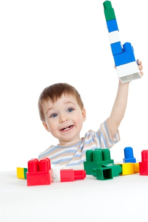 game block: little cheerful child with construction set over white background