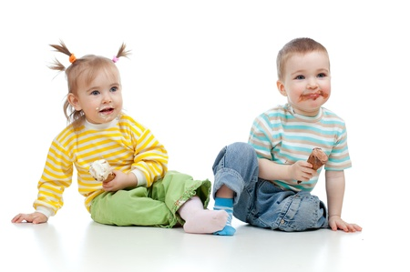 happy children little girl and boy with ice cream in studio isolated photo