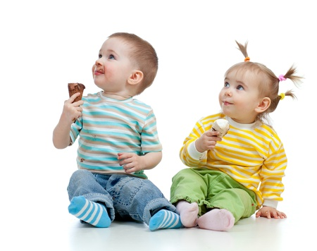 happy children little girl and boy with ice cream in studio isolated Stock Photo - 12584231