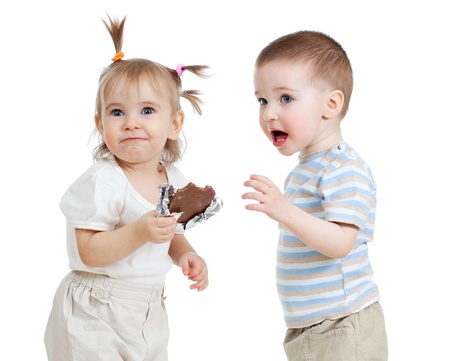 funny children eating chocolate isolated on white photo