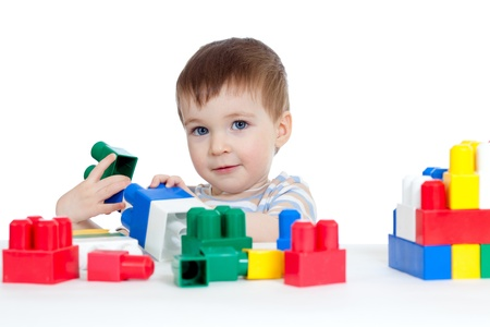 kiddy: little cheerful child with construction set over white background