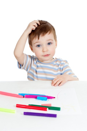 little puzzled child with color pen over white Stock Photo - 12584234