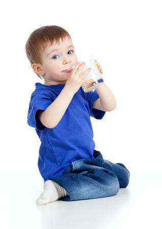 baby drinking yogurt or kefir over white Stock Photo