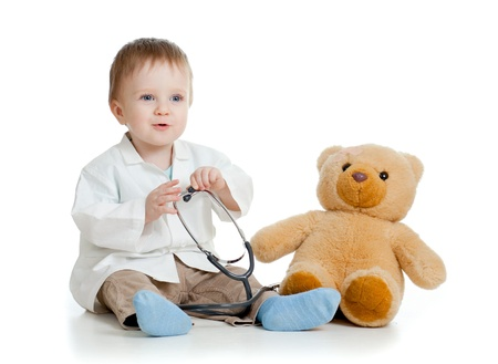Adorable boy with clothes of doctor isolated on white Stock Photo - 12675563