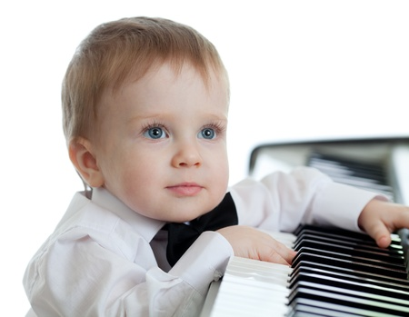 playing piano: adorable child playing electronic piano