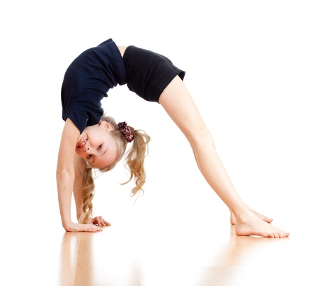 acrobat gymnast: young girl doing gymnastics over white background