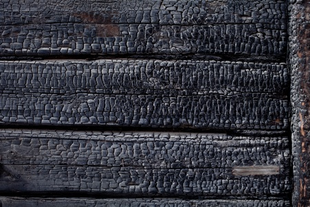 Black burnt wooden wall photo