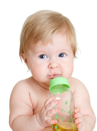 adorable child drinking from bottle  6 months old girl  photo