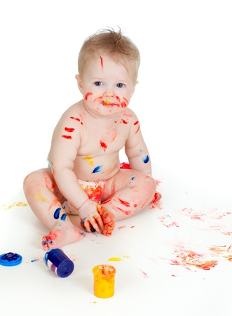smudgy: Happy dirty child with paints. Isolated on white background