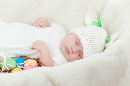 adorable baby dressed in Easter bunny cap with eggs Stock Photo - 12910992