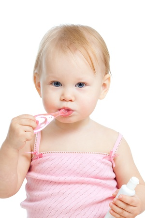 teeth cleaning: baby cleaning teeth and smiling, isolated on white background