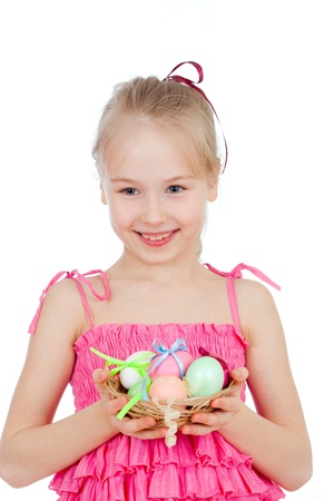cute smiling little girl holding Easter eggs in basket photo