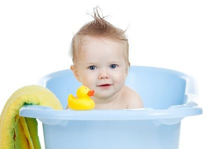 cute baby having bath in blue tub photo