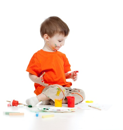Adorable dirty child with paints Stock Photo - 12976271