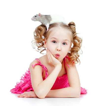 funny little girl with pet rat on her head photo