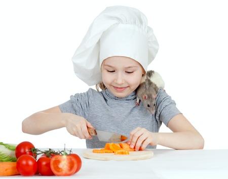 Chef girl preparing healthy food, helper rat are sitting on her shoulder  photo