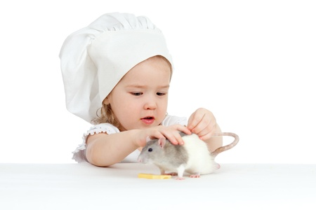 Little girl playing with domestic rat  photo