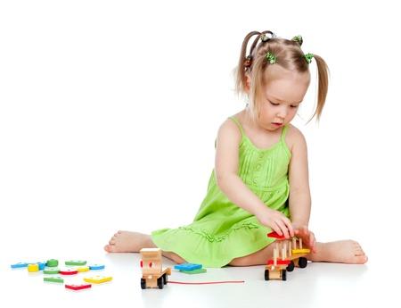 developmental: pretty little girl playing with developmental toy