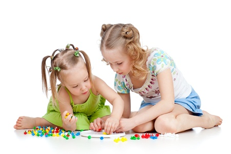 children playing with color toy over white background Stock Photo