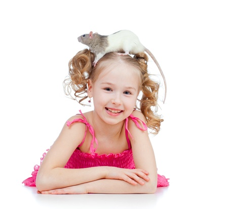 little girl with pet rat on her head photo
