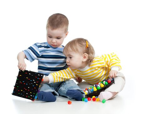 Children playing with  mosaic toy over white background photo