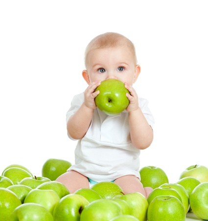 kids food: Adorable child with green apples