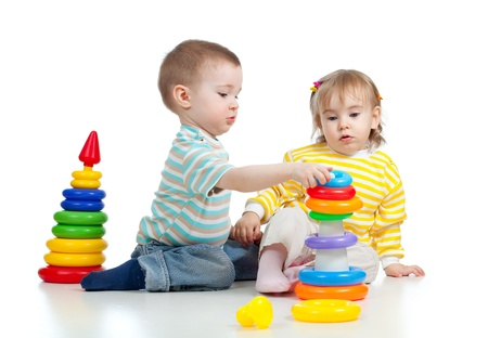 two little children playing with color toys photo
