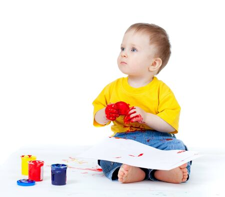 Adorable dirty child with paints photo