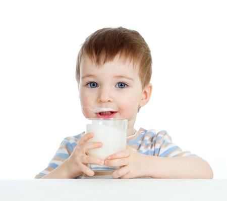 baby drinking yogurt or kefir over white photo